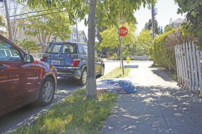 Anna Schuessler/Daily Journal To address the presence of litter and large items dumped in San Mateo's North Central neighborhood, residents are coordinating a cleanup day June 9 and asking each other to take a pledge to keep streets clean.